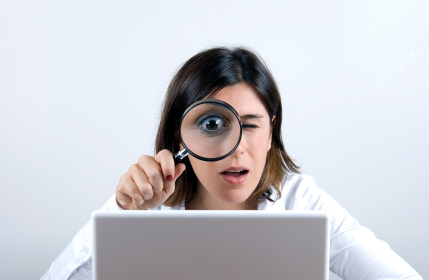 magnifying-glass-and-computer