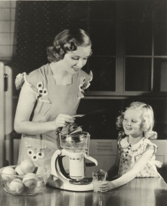 Mother and daughter use GE electric juicer.