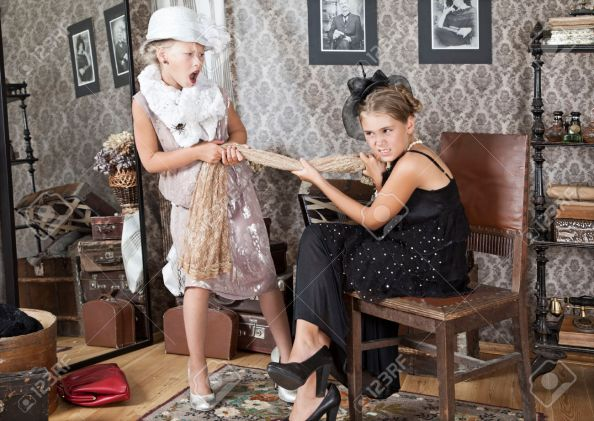 Two little girls are arguing for Grandma's dress