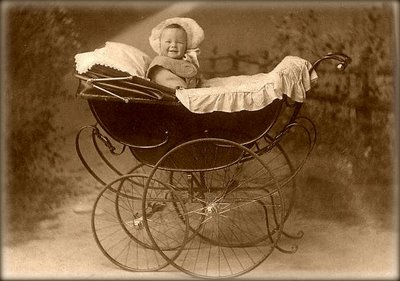 Vintage-pram-with-baby